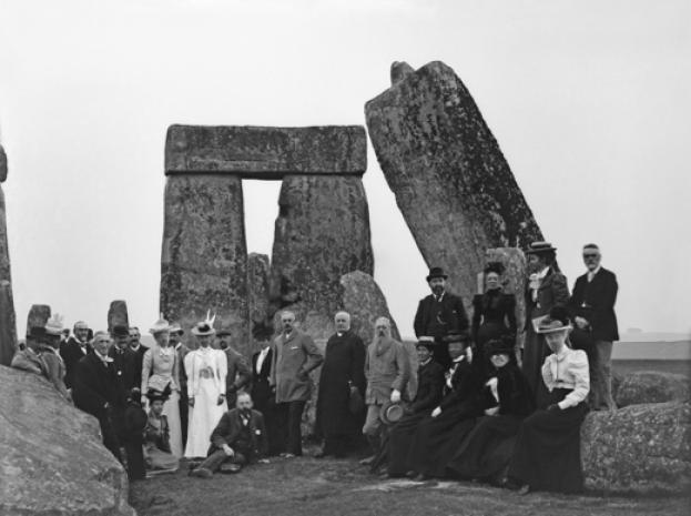 A group of Victorian tourists pose in front of Stonehenge, c1900. © Corbis